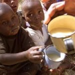 Malnourished children receive donated food.